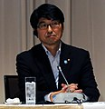 Tomihisa Taue cropped 1 Yukiya Amano and Tomihisa Taue 20110727.jpg