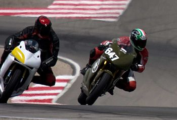 English: Two motorcycle trailing off the brake...