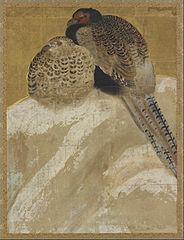 Two pheasants on a snow bank