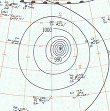 Map of a tropical cyclone's position and other meteorological variables. The map shows isobars, or contours of barometric pressure, as lines with numbers denoting the pressure.