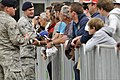 U.S. Air Force Senior Airman Corey Moore, left, a patrolman with the 48th Security Forces Squadron, and another Airman talk to visitors during the Farnborough International Airshow 2012 in Farnborough, United 120715-F-RP755-111.jpg