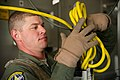 U.S. Air Force Staff Sgt. Evan Kiber, an aeromedical service journeyman with the 34th Aeromedical Evacuation Squadron, attaches a power cord to a stanchion inside a C-17 Globemaster III aircraft during Joint 140313-F-RW714-058.jpg