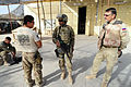 U.S. Army Cpl. Terry Proud, left, a member of the Farah Provincial Reconstruction Team (PRT), briefs team members to prepare them for a mission to Farah at Forward Operating Base Farah, Farah province 120829-N-II659-0215.jpg