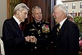 U.S. Marine Corps Gen. James F. Amos, center, the commandant of the Marine Corps, and retired U.S. Sen. John Warner, left, a former secretary of the Navy and the Evening Parade guest of honor, exchange greetings 130503-M-LU710-037.jpg