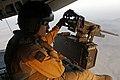 U.S. Marine Corps Staff Sgt. Peter A. Montalvo, a crew chief with Marine Heavy Helicopter Squadron (HMH) 461, provides aerial security using a GAU-21 .50-caliber machine gun aboard a CH-53E Super Stallion 130820-M-SA716-111.jpg