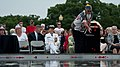 U.S. Navy Rear Adm. Nora W. Tyson, seated center, the vice director of the Joint Staff, looks on as a man throws rose petals into a reflecting pond during a Memorial Day ceremony at the Women in Military Service 130527-D-KC128-013.jpg