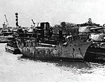 U.S. Navy sludge removal barge YSR-42 alongside of USS Oklahoma (BB-37) at Pearl Harbor, circa in 1944.jpg
