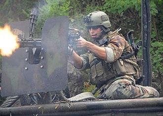 Minigun - A U.S. Navy Special Warfare Combatant-craft Crewmen (SWCC) firing a Minigun at the Stennis Space Center in Mississippi, August 2009