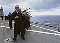 U.S. Sailors fire a gun salute during a burial at sea aboard the amphibious dock landing ship USS Carter Hall (LSD 50) in the Atlantic Ocean March 18, 2013 130318-N-XZ031-039.jpg