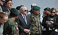 U.S. Secretary of Defense Robert Gates watches a combat scenario performed by the Afghan National Army while visiting Kabul Military Training Center (KMTC) (4421786967).jpg