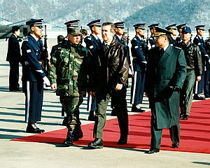 John H. Tilelli Jr. - Tilelli, left, greeting Defense Secretary William Cohen during his arrival in South Korea in January 1998.