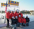 US Navy 031024-O-0000V-001 Members of SEAL Wives Against Terrorism, or 'SWAT', gather for a photo before leaving the Columbia Island Marina docks.jpg