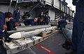 US Navy 040126-N-7871M-001 Fire Controlman work as a team to load a NATO Sea Sparrow missile aboard USS George Washington (CVN 73).jpg