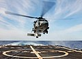US Navy 040309-N-4374S-014 An HH-60H Seahawk assigned to the Red Lions of Helicopter Anti-Submarine Squadron One Five (HS-15) approaches the flight deck aboard the guided missile frigate Taylor (FFG 50).jpg