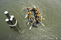 US Navy 040518-N-9693M-003 A squad of Midshipmen paddle a rubber boat under a footbridge as part of competition in Sea Trials.jpg