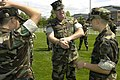 US Navy 040625-N-6477M-059 Master-at-Arms 1st Class Brian Barker, center, assigned to Naval Station Everett, Wash., demonstrates proper handcuffing procedures to a group of U.S. Naval Sea Cadets.jpg