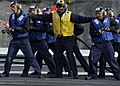 US Navy 041223-N-8604L-033 Sailors stand ready with fire hoses during an emergency-landing barricade drill aboard the conventional powered aircraft carrier USS Kitty Hawk (CV 63).jpg