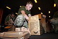 US Navy 050101-M-5538E-048 Cpl. Mathew R. Loper helps prepare pallets of Meals Ready to Eat (MREs) for victims of the recent Tsunami in the Indian Ocean.jpg