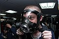 US Navy 050202-N-3390M-055 Gas Turbine System Technician Fireman Ben Olsen tightens his facemask.jpg