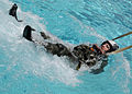 US Navy 050623-N-9698C-057 A student attending the refresher course in water survival at Aviation Survival Training Center, Marine Corps Air Station Miramar, is dragged with a pulley in a pool.jpg