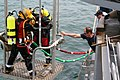 US Navy 060508-F-6344A-002 Senior Chief Navy Diver Clifford Morin aboard rescue and salvage ship USS Safeguard (ARS 50) tends the dive stage as fellow divers are lowered into the Yellow Sea during a major recovery effort.jpg