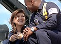 US Navy 060510-N-1328C-148 Sgt. Deo Harrypersaud, crew chief of the Blue Angels ^7 plane, discuss safety with RCA recording artist and American Idol winner Kelly Clarkson prior to a flight.jpg