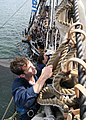 US Navy 060901-N-5367L-002 Seaman Rob Holcomb douses the flying jib on bowsprit aboard USS Constitution.jpg