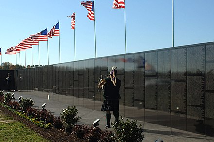 The Moving Wall at Mount Trashmore Park in Virginia US Navy 061117-N-5307M-113 John Nugent, Vietnam veteran, plays the bagpipes as a part of the opening ceremony at the Dignity Memorial Vietnam Wall at Mt. Trashmore Park.jpg