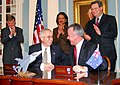 US Navy 061212-N-0962S-037 Deputy Secretary of Defense Gordon R. England and Australian Minister for Defense Brendan Nelson shake hands after signing the Joint Strike Fighter (JSF) Memorandum of Understanding.jpg
