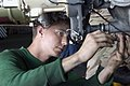 US Navy 070824-N-5387K-015 viation Electrician's Mate 3rd Class Richard Stevenson tightens screws on the main gear box wire harness of an SH-60F Seahawk.jpg