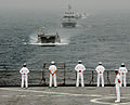 US Navy 080202-N-8933S-003 Africa Partnership Station (APS) Sailors watch as landing craft utility (LCU) 1655 leads a formation of the Equatorial Guinea Navy behind the APS flagship, the dock landing ship USS For.jpg
