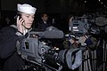 US Navy 080211-N-5484G-013 Mass Communication Specialist 2nd Class Hermes Crespo works a video camera at a press conference with the commander of Carrier Strike Group (CSG) 11.jpg