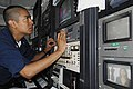 US Navy 080711-N-3946H-070 Interior Communications Electrician 3rd Class Xavier Cuevas, of Woodland Hills, Calif., calibrates a television monitor.jpg
