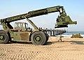 US Navy 080716-N-1424C-593 A Kalmar Rough Terrain Container Handler travels along Red Beach during the construction of the elevated causeway system.jpg