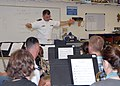US Navy 080923-N-4649C-004 Lt.j.g. Patrick Sweeten conducts a music class at McNary High School.jpg