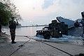 US Navy 090207-N-6936D-026 Seaman Matthew Atkinson directs vehicles as they arrive by landing craft in Sattahip, Thailand.jpg