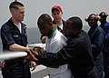 US Navy 090213-N-1655H-020 Africa Partnership Station embarked trainees practice manning a fire hose aboard the amphibious transport dock ship USS Nashville (LPD 13) during damage control training.jpg