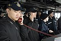 US Navy 090318-N-9123L-003 Ensign Allan Aw and Republic of Korea Navy Ensign Do-Hee Jung conduct communications between the guided-missile destroyer USS John S. McCain (DDG 56) and the Republic of Korea Navy oiler Hwachon (AOE.jpg