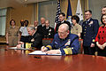 US Navy 090401-N-8273J-014 Chief of Naval Operations (CNO) Adm. Gary Roughead, left, and Commandant of the Coast Guard Adm. Thad W. Allen sign a memorandum of agreement for the Safe Harbor program during a signing ceremony at t.jpg