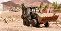 US Navy 090404-N-1057H-150 Equipment Operator Constructionman Apprentice Graeme Hathaway, assigned to Naval Mobile Construction Battalion (NMCB) 11 Detachment Horn of Africa, drives a backhoe.jpg