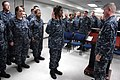 US Navy 091215-N-9818V-034 Master Chief Petty Officer of the Navy (MCPON) Rick West reenlists a chief petty officer before a chief petty officer's call.jpg
