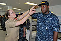 US Navy 100109-N-7042K-093 Aviation Electrician's Mate 1st Class Lauren Tarkington, left, a recruit division commander, shows Seaman Recruit Jarrell Thompson the proper way to salute during training at Recruit Training Command.jpg
