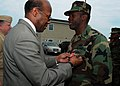 US Navy 100423-N-4267W-083 Dr. Clifford L. Stanley, Under Secretary of Defense for Personnel and Readiness, awards the Bronze Star medal to Explosive Ordnance Disposal Technician 1st Class Dewayne Cheatham.jpg