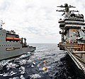 US Navy 100603-N-6003P-158 The Military Sealift Command dry cargo and ammunition ship USNS Sacagawea (T-AKE 2) transports supplies to the Nimitz-class aircraft carrier USS Harry S. Truman (CVN 75) during a replenishment at sea.jpg