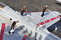 US Navy 100612-N-3595W-004 Sailors assigned to the Patriots of Electronic Attack Squadron (VAQ) 140, clean an EA-6B Prowler on the flight deck of the aircraft carrier USS Dwight D. Eisenhower (CVN 69).jpg
