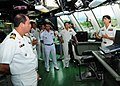 US Navy 100627-N-3570S-105 Cmdr. Kris Doyle, commanding officer of the littoral combat ship USS Freedom (LCS 1), explains the ships bridge to representatives of the 14 nations participating in Rim of the Pacific (RIMPAC) 2010.jpg