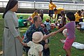 US Navy 100821-N-2729A-003 Lt. Kermit Jones greets children from the Fujisawa City Misono Orphanage during a community relations project sponsored by Cowpens and the U.S. Naval Hospital Yokosuka.jpg