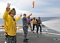 US Navy 101007-N-8113T-044 Aviation Boatswain's Mate (Handling) Airman Adam Pond, left, directs hose teams fighting a simulated aircraft fire durin.jpg