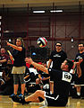 US Navy 110518-N-UD644-182 Chief Special Operator Dan Cummings serves during a Warrior Games sitting volleyball match against the Air Force.jpg