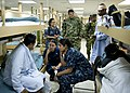 US Navy 110604-N-RM525-051 Rev. Juan Garcia, right, a Roman Catholic priest from the Colombian navy, visits with patients during a tour of the Mili.jpg